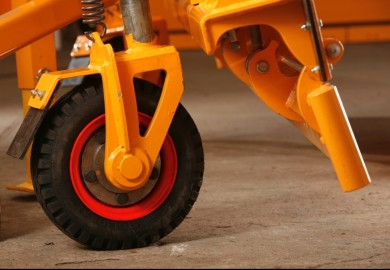 Adjustable support wheel for highway snow plow